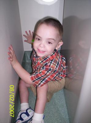 Chance is happy as a lark at his last chemo party. He is 3 in  this picture